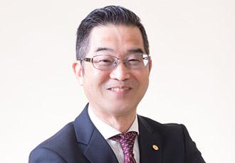 対応スタッフの藤崎 信義